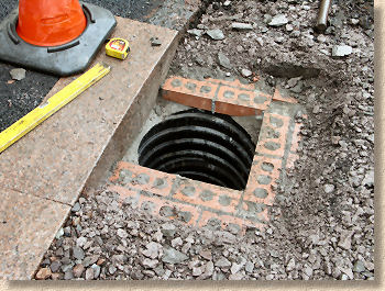 'regulating brickwork for gully' from the web at 'http://www.pavingexpert.com/images/features/regulate_gully.jpg'