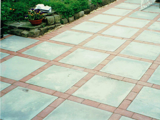 patio of mixed pcc flags with block pavers