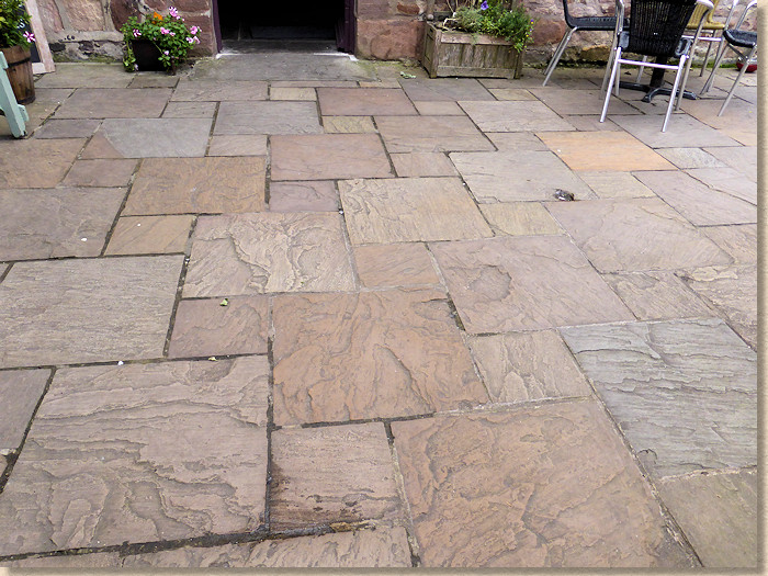 dutch pattern riven sandstone paving