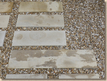 staining on textured stone linear paving