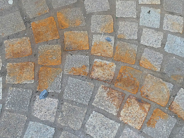 rust stained paving