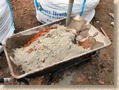 'mixing mortar' from the web at 'http://www.pavingexpert.com/images/mortar/mortar_mix_01.jpg'