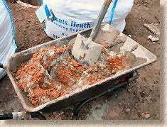 'mixing mortar' from the web at 'http://www.pavingexpert.com/images/mortar/mortar_mix_02.jpg'