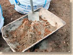 'mixing mortar' from the web at 'http://www.pavingexpert.com/images/mortar/mortar_mix_03.jpg'
