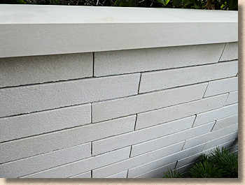 shot-textured off-white stone walling