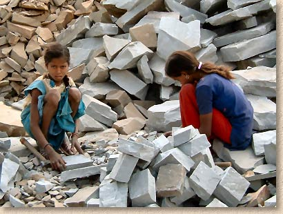 children cutting stone