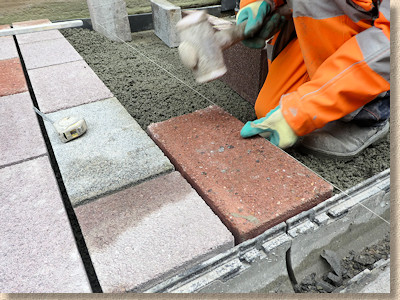 paver is hammered down to level