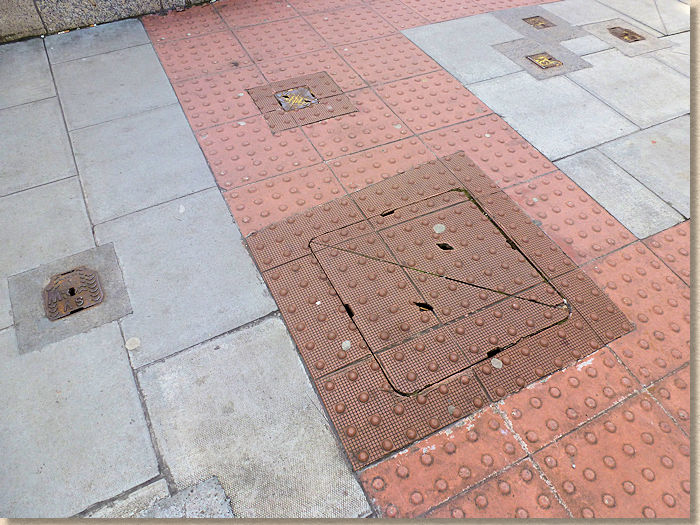 mix of concrete and surface-mounted tactiles in dublin