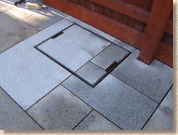 recess tray fitted into granite flagstones